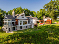 BREATHTAKING NILES ESTATE WITH SUBSTANTIAL ACREAGE AND WATER FRONTAGE