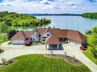 A RARE LAKEFRONT HOME ON THE MAIN CHANNEL OF TELLICO LAKE