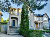 BEAUTIFULLY MAINTAINED CUSTOM-BUILT HOME WITH GARDENS