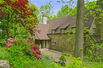 ELEGANT 1930'S MEDIEVEL REVIVAL HOME WITH BEAUTIFUL LANDSCAPED YARD