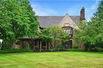 SPECTACULAR ENGLISH TUDOR UPDATED AND EXPANDED TO PERFECTION