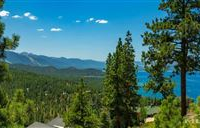 THIS ONE OF A KIND, PANORAMIC LAKE AND MOUNTAIN VIEW HOME