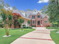 CUSTOM CRAFTED ALL-BRICK WATERFRONT HOME