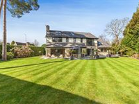 AN IMMACULATE COTSWOLD STONE BESPOKE DESIGNED RESIDENCE