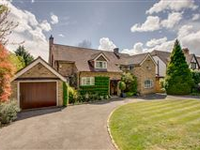 THIS FINE HOME SITS WELL WITHIN BEAUTIFULLY LANDSCAPED MATURE GARDENS