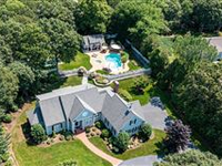 BEAUTIFUL CUSTOM HOME OFFERS ELITE FINISHES AND PRIVACY