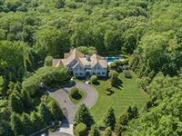 IMPECCABLE HOME ON TWO PRIVATE LANDSCAPED ACRES