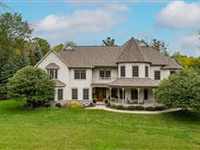 EXTRAORDINARY HOME ON PRIVATE WOODED ACRE