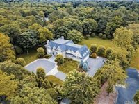 IMMACULATE HOME ON TWO GATED ACRES