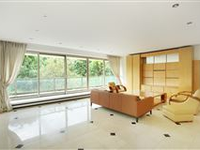A LUXURIOUS RESIDENCE FACING THE WOODS  OFFERS A WIDE SOUTH-FACING BALCONY