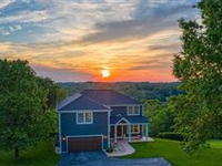 STUNNING NEW HOME WITH SPECTACULAR SUNSET VIEWS