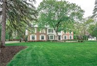 STUNNING COLONIAL ON PICTURESQUE AND PRIVATE LOT