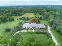 ENJOY PRIVACY AND RESORT STYLE LIVING IN THIS GORGEOUS FRENCH COUNTRY HOME