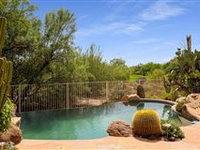 ENJOY SUPERIOR OUTDOOR LIVING IN THIS CLASSIC BOULDERS HOME