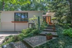 STYLISH MID-CENTURY MODERN HOME WITH GORGEOUS VIEWS OF BERKSHIRE CREEK NATURE AREA