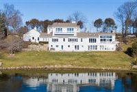 THIS SPECTACULAR UPDATED LAKE HOME HAS OVER 230 FEET OF PRISTINE FRONTAGE