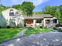 IMPRESSIVE COLONIAL ON A SECLUDED ACRE