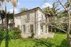 DUAL-LEVEL ITALIAN VILLA STYLE HOME