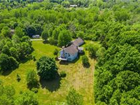 PICTURESQUE ANDPRIME SETTING IN VICTOR ON 37 ACRES