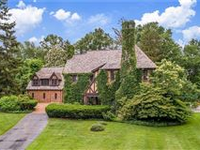 BEAUTIFUL TUDOR IN THE HEART OF PEPPER PIKE WITH EXCEPTIONAL ARCHITECTURAL DETAILS