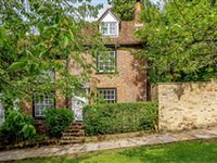 A CHARMING END OF TERRACE PERIOD PROPERTY ON A LOVELY TREE-LINED ROAD