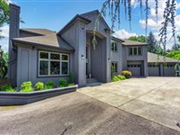 PRIVATE FRENCH-STYLE STUCCO HOME IN MEDFORD