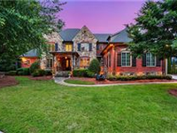 STUNNING HOME ON OVER AN ACRE IN EXCLUSIVE GATED COMMUNITY