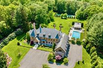 UNCOMPROMISING FRENCH NORMANDY-INSPIRED HOME ON FOUR ACRES