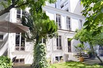 AN EXCLUSIVE CHARMING THREE LEVEL HOME WITH A PRIVATE GARDEN