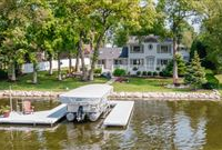LUXURY LAKE HOME WITH STUNNING DETAILS AND FINISHES THROUGHOUT