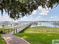 IMMACULATE RIVERFRONT HOME WITH SPECTACULAR SUNSET VIEWS