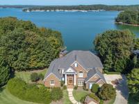 CUSTOM BRICK HOME BUILT FOR LAKE LIFE