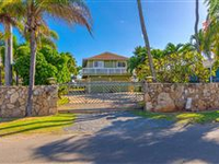 GATED BEACHFRONT PROPERTY WITH TWO HOMES