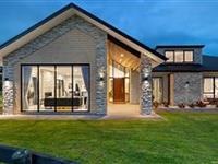 STRIKING DESIGNER HOME SET ON EXPANSIVE LOT