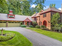 STONE AND SHINGLE MANOR IN EXCEPTIONAL CHAGRIN RIVERFRONT LOCATION
