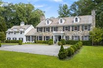 HANDSOME STONE AND CLAPBOARD COLONIAL IN PRIVATE SETTING