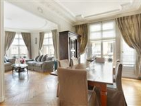 CHARMING APARTMENT IN A FINE TURN-OF-THE-CENTURY HAUSSMANNIAN BUILDING BOASTS PERIOD FEATURES