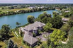 COVETED LAKE FRONTAGE IN GATED LUCKY LAKE