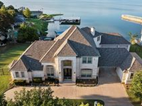 EXCEPTIONAL LAKE FRONT HOME IN SOUGHT AFTER GATED COMMUNITY OF BAY CLUB
