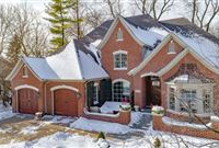 SPACIOUS CUSTOM HOME NESTLED AWAY ON WOODED SETTING IN SAYBROOK