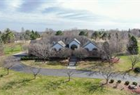 UNIQUE AND STYLISH HOME ON A WONDERFUL, PRIVATE THREE PLUS ACRES