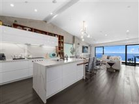 COMPLETELY UPGRADED AND REMODELED HOME WITH PANORAMIC OCEAN VIEWS