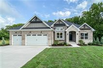 LUXURIOUS DREAM HOME ON SCENIC WOODED ACRE SITE