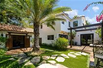SPANISH-STYLE HOME TASTEFULLY REMODELED WITH TOP-QUALITY FINISHES