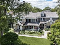 EXQUISITE NEWER CONSTRUCTION HOME SITUATED ON A SUNNY CORNER LOT