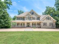 CHARMING COLONIAL IN QUEENS LAKE COMMUNITY