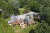 GRIMSWORTHY MANOR IS A MAGNIFICENT GATED ESTATE ON SECLUDED TWO PLUSACRES