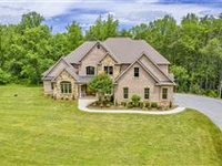 CUSTOM-BUILT BRICK AND STONE ESTATE HOME IN A PEACEFUL SETTING