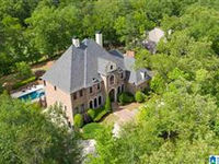 SPRAWLING CUSTOM HOME WITH COUNTLESS AMENITIES
