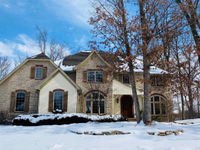 DISTINCTIVE, UNIQUE CUSTOM HOME NESTLED ON PRIVATE WOODED LAKE LOT
